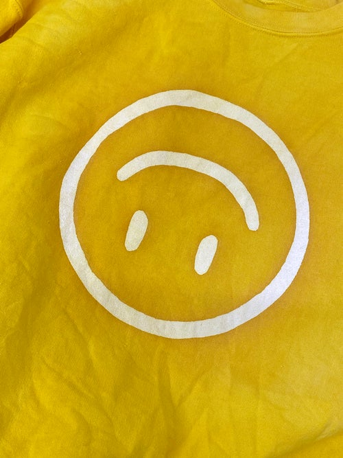 Image of UPSIDE DOWN HAPPY FACE SWEATSHIRT / NATURAL DYE - YELLOW