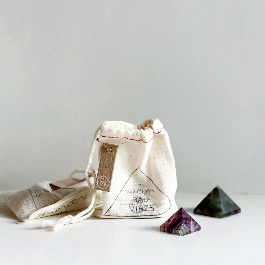 Image of FLUORITE MINI PYRAMID / VANQUISH BAD VIBES