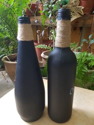 A set of 2 medium size chalkboard bottles for Christmas messages
