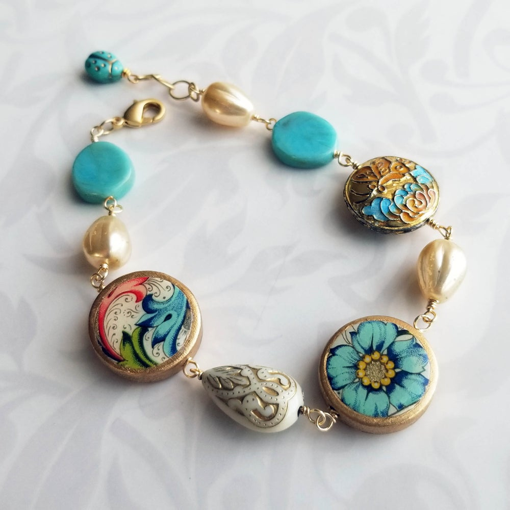 Image of Florentine Bracelet – Blue Flower + Flourish Coins