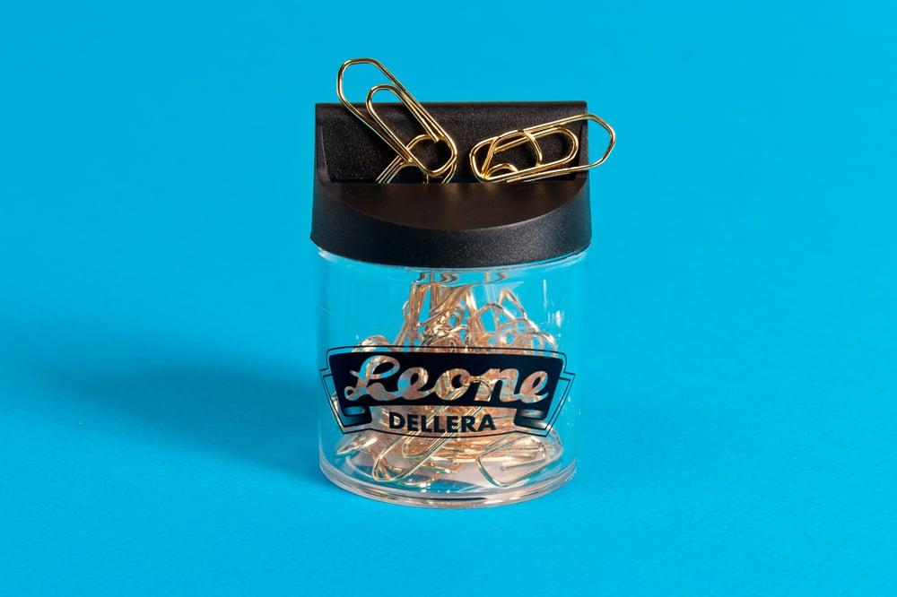 Image of FERMAGLI DORATI 24K CON DISPENSER / LEONE DELLERA 24K GOLD PLATED PAPERCLIPS AND DISPENSER