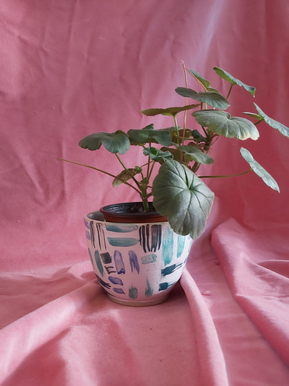 Image of small green blue and white planter