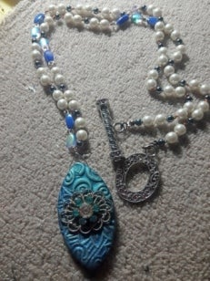 Image of Blue Beaded Necklace With Ceramic Pendant