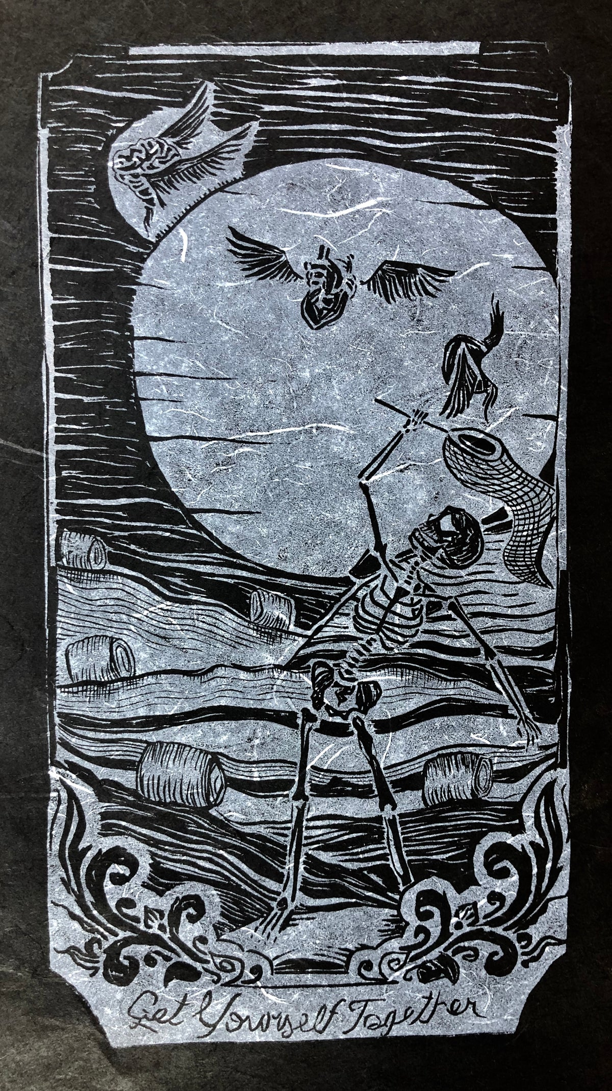 "Image of ""Get Yourself Together"" linocut on black paper"