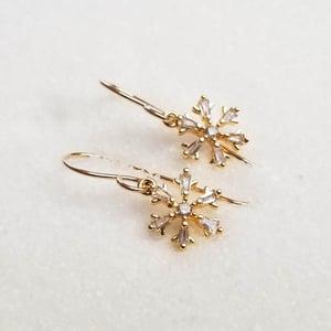 Image of Simple Golden Snowflake Earrings
