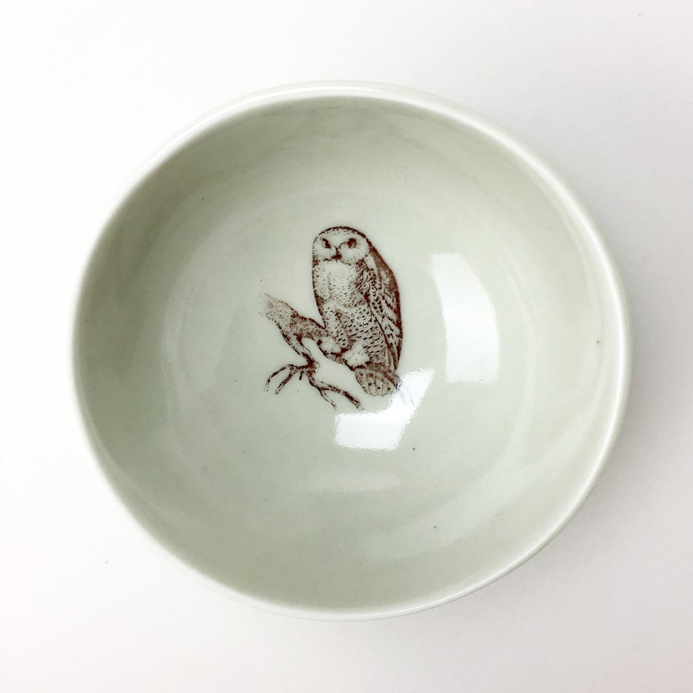Image of roly poly bowl with owl,  stone