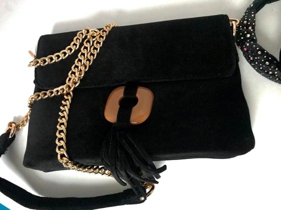Image of black velour purse