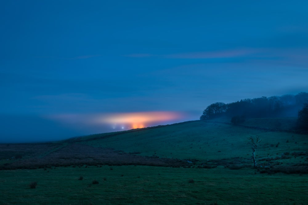 Image of DARTMOOR. PRINCETOWN LIGHTS THE DUSK SKY