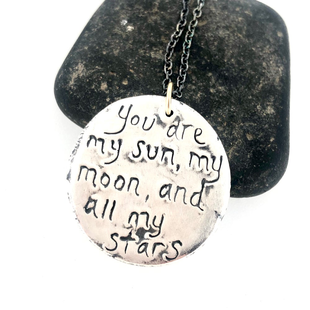 Image of E. E. Cumming quote necklace with sapphires