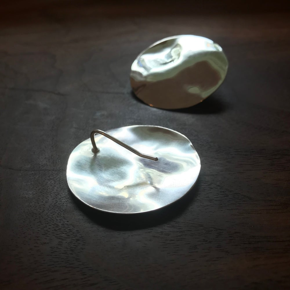 Image of Silver reflective pool earrings