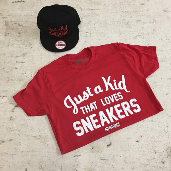 "Image of JUST A KID THAT LOVES SNEAKERS ""ROYAL or RED W/ WHITE PRINT"" T-SHIRT"