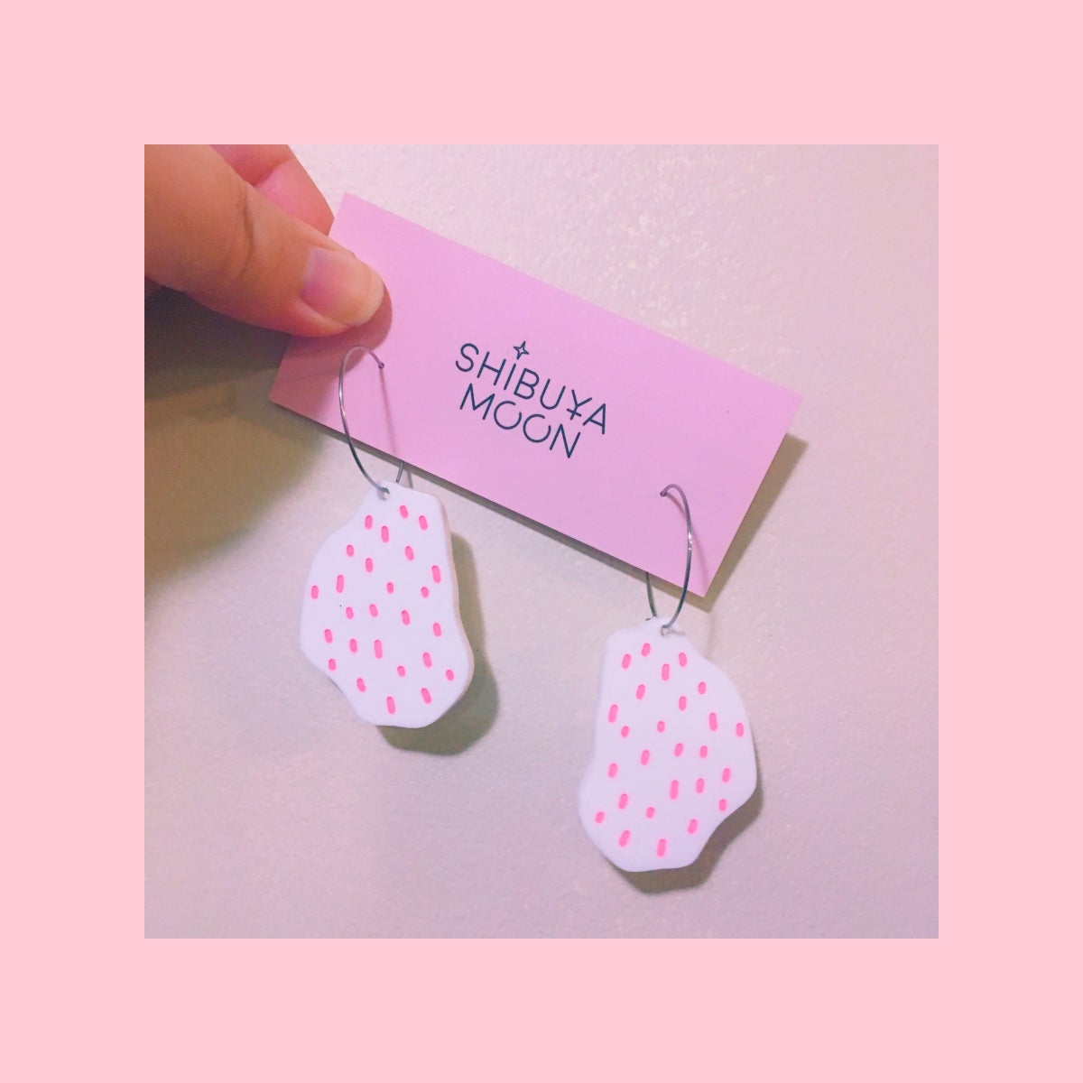 Image of Confetti Rocks Mini Hoops (White/Neon Pink)