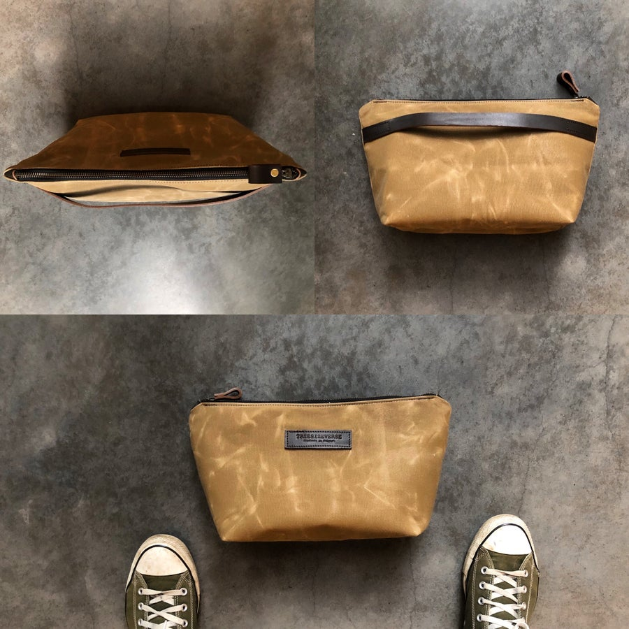 Image of Waxed canvas toiletry bag with luggage handle attachment