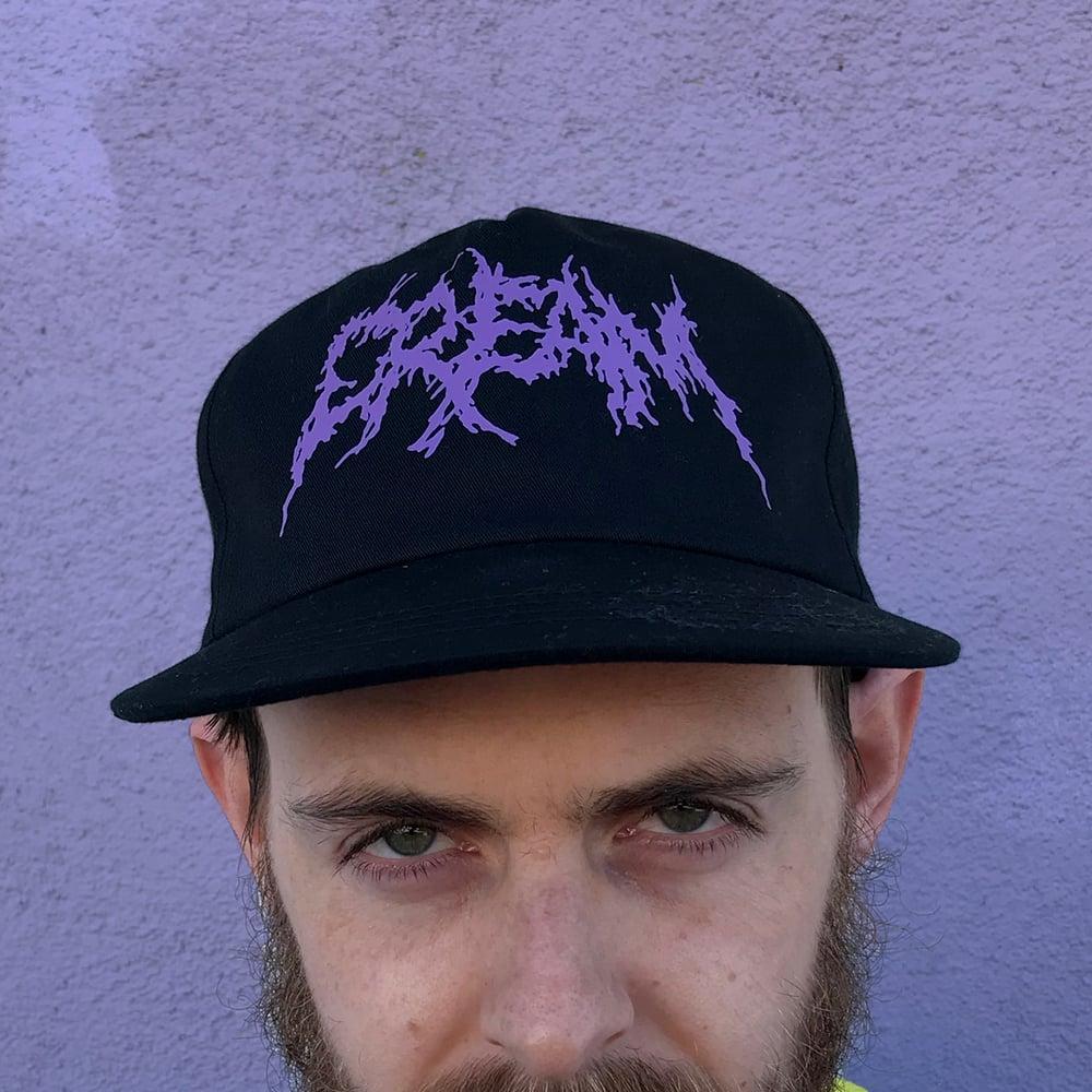 "Image of ""Black Metal CREAM"" - Black Snapback with Purple Print"