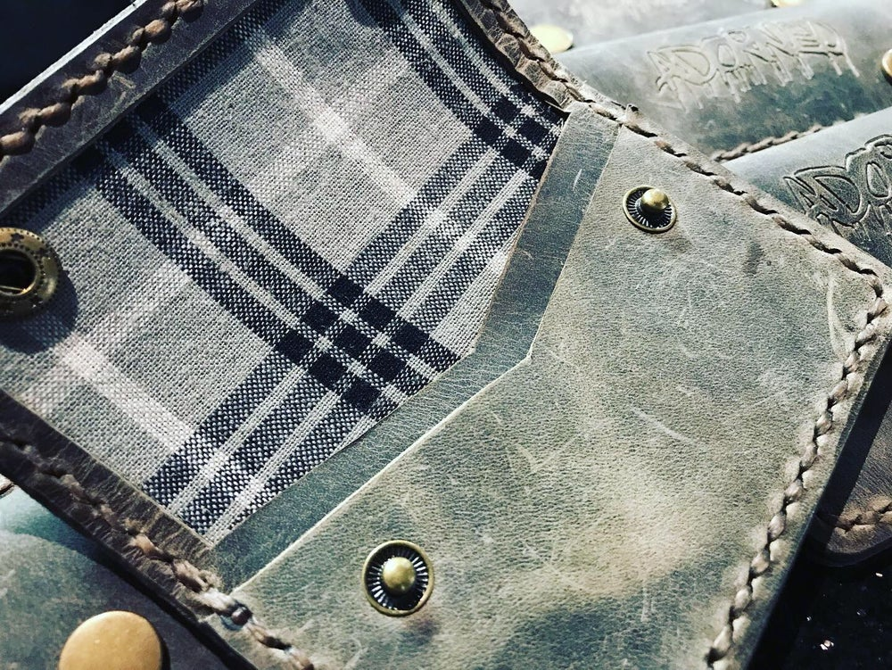 Image of ADORNED X CUTLASS LEATHER GOODS