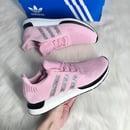 Image of Swarovski Women's Adidas Swift Run Shoes Pink customized with Swarovski Crystals.