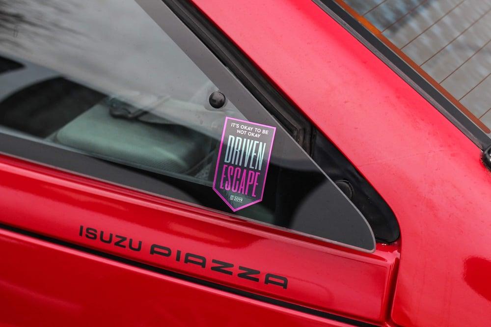 Tinted Chrome Driven Escape Shield Sticker