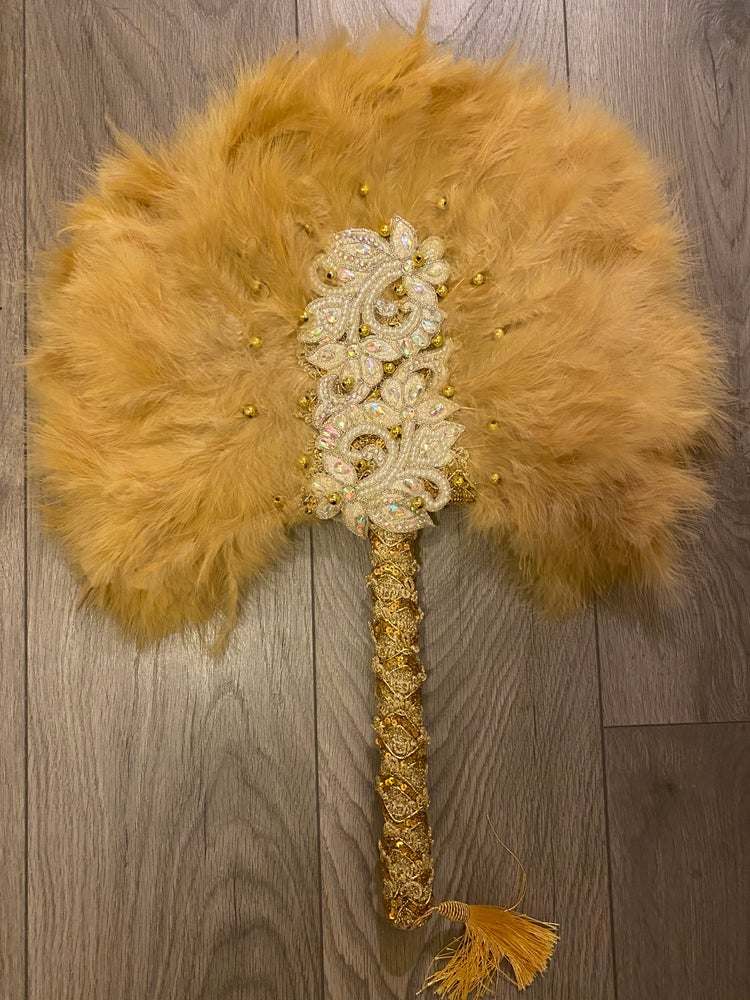 Image of Gold long handle hand fan