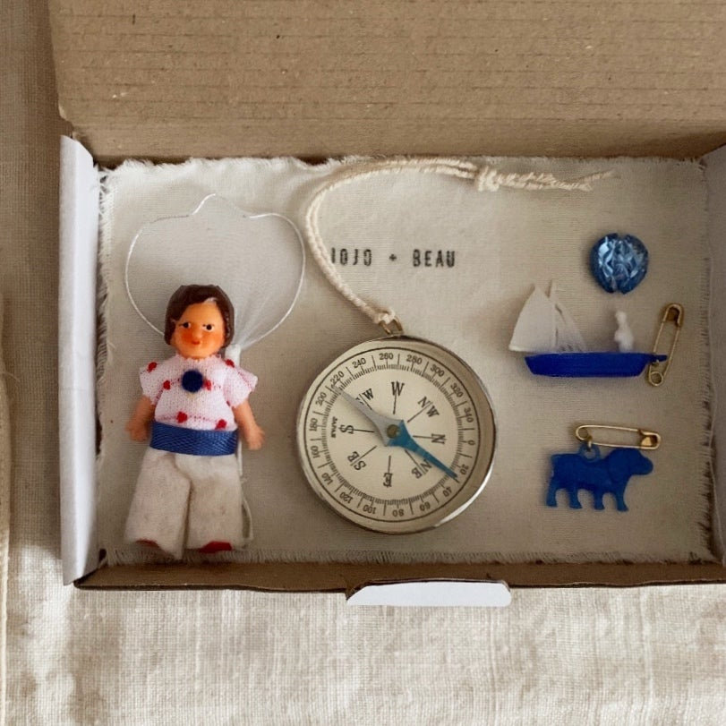 Image of Vintage doll with a toy compass