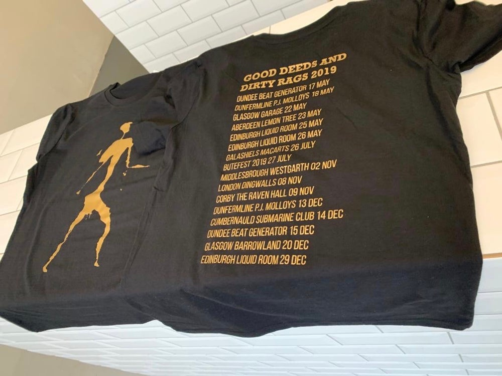 Image of Mackenzie Man - GOLD on a black tshirt with anniversary tour dates