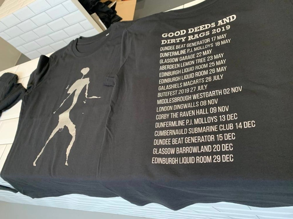 Image of Mackenzie Man - SILVER on a black tshirt with anniversary tour dates