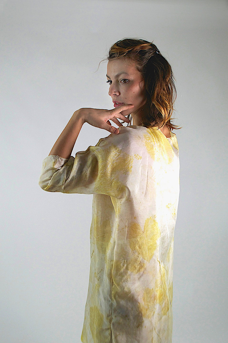 Image of golden feather weight tunic