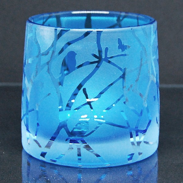 Image of Blue tealight holder with twigs and stars design