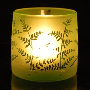 Image of Green tealight holder with plants design