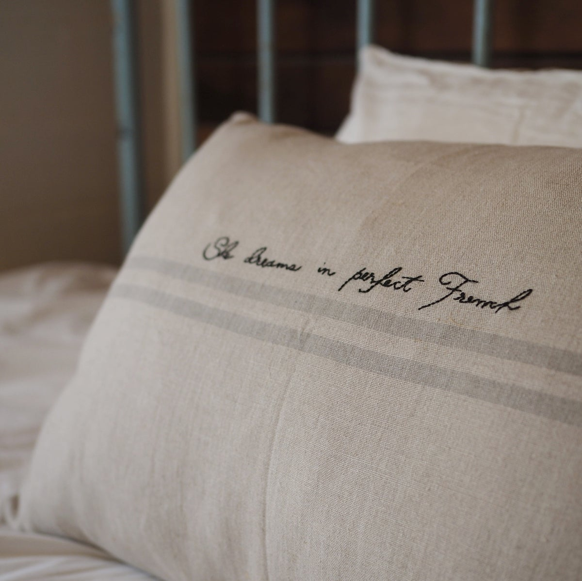 Image of french consul cushion cover + hand stitched words pre-order
