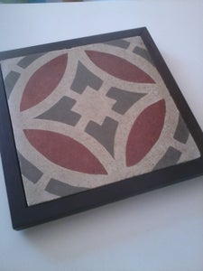 Image of Grey and burgandy framed cement tile