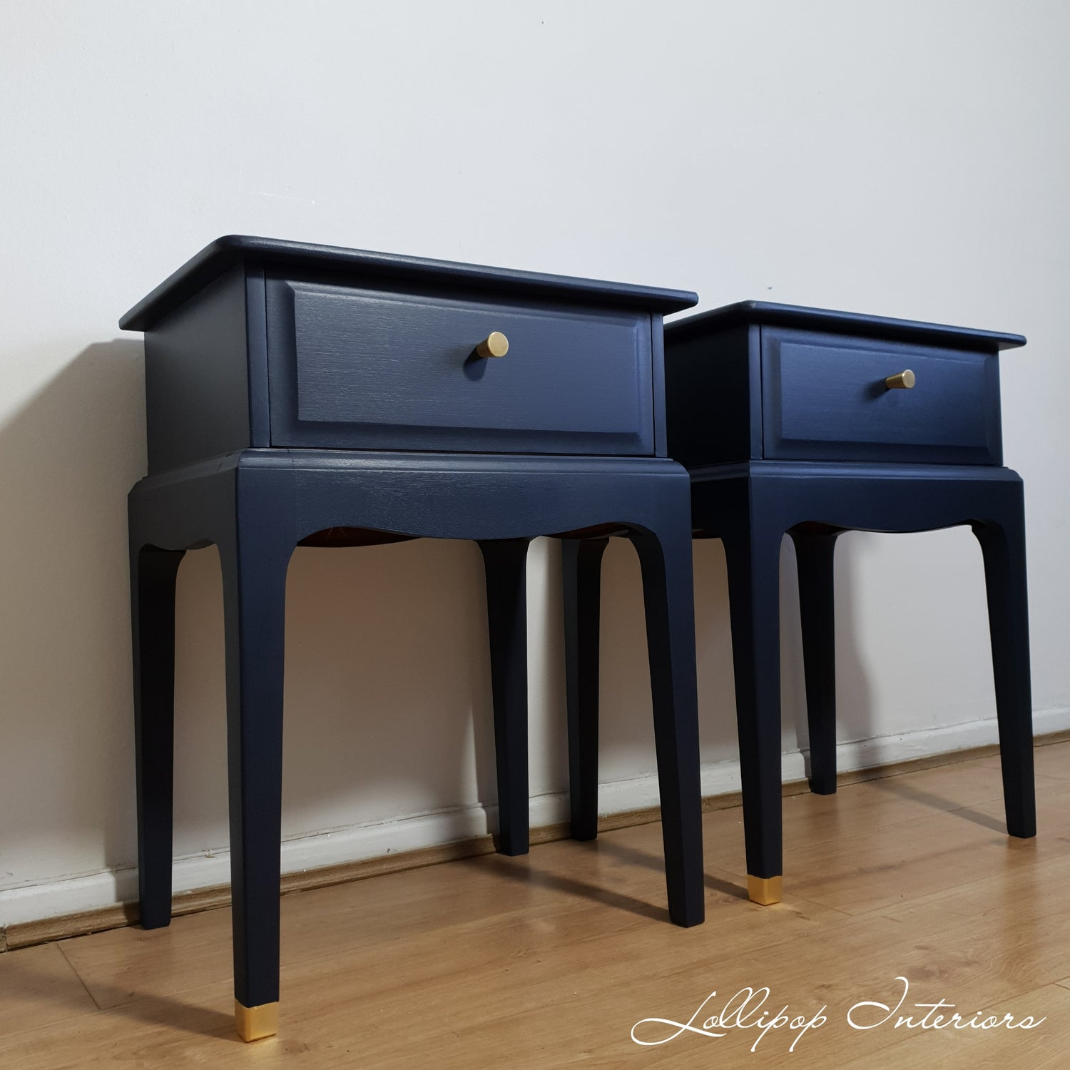Image of Navy stag bedside tables with brass cone handles