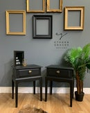 Image 1 of A pair of black stag side tables