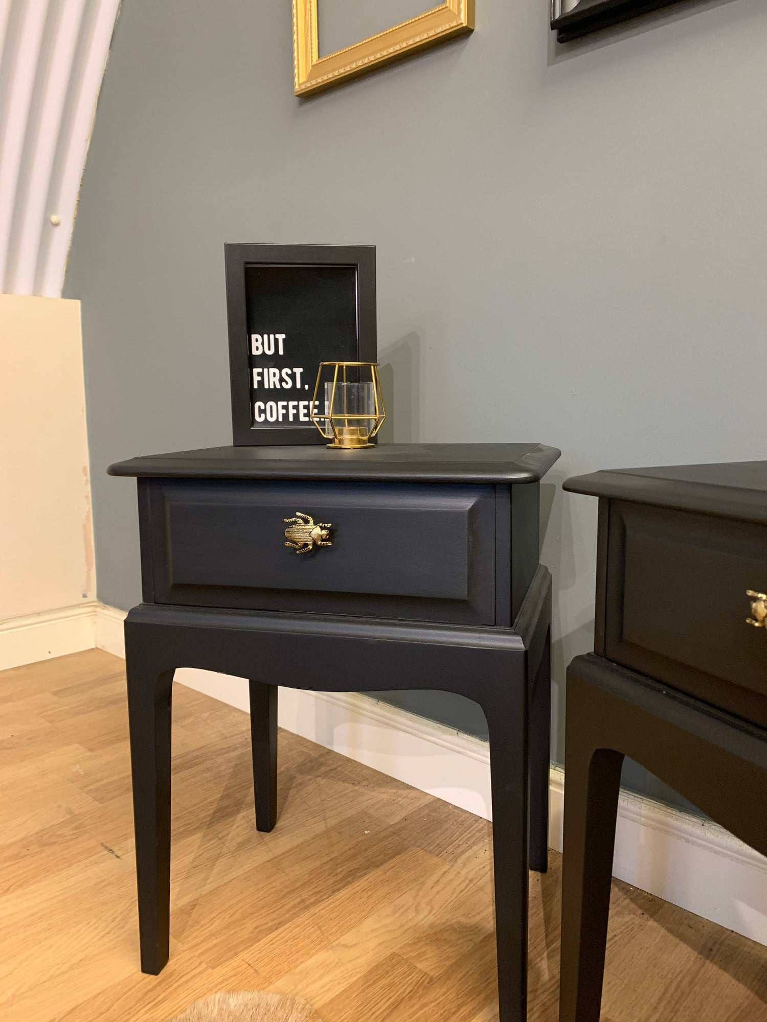 Image of A pair of black stag side tables