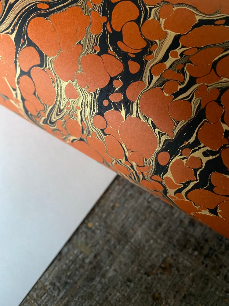 Image of Russet orange base paper with gold and black vein