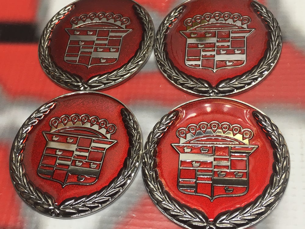 Image of Red chrome Cadillac chips