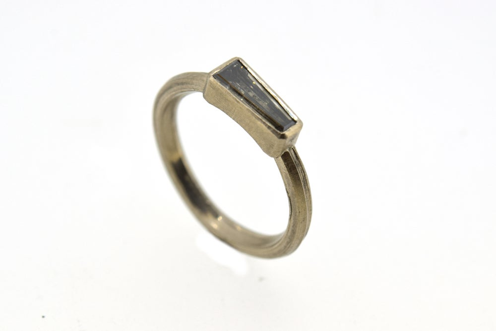 Image of 18ct white gold ring set with a tapered baguette cut diamond