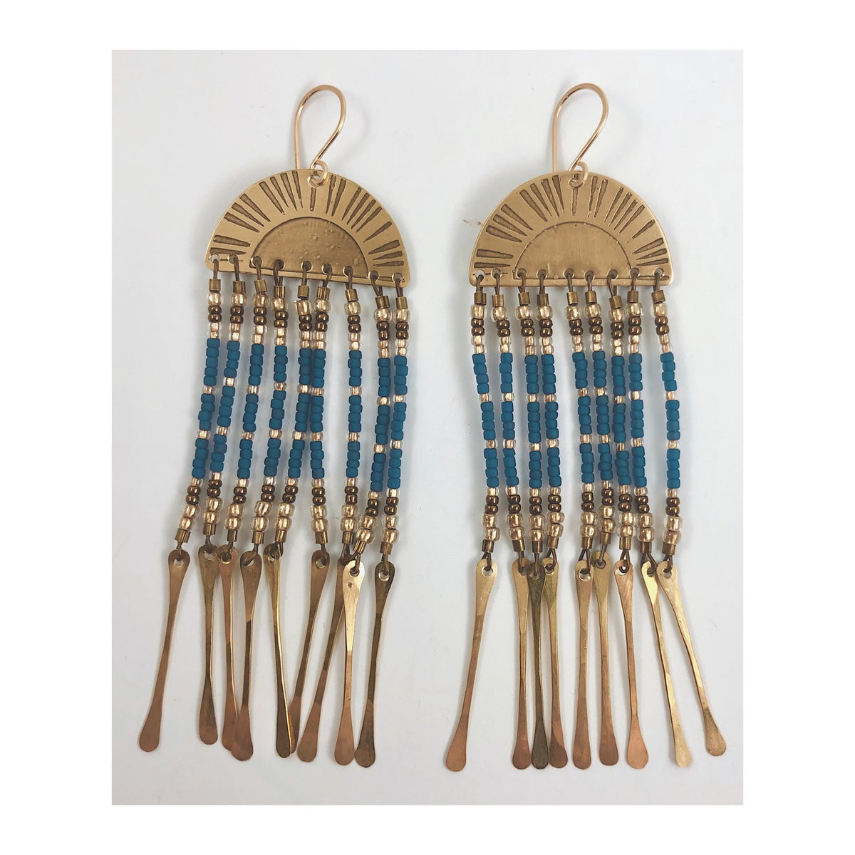 Image of Sunset w Blue and Brass Tassels