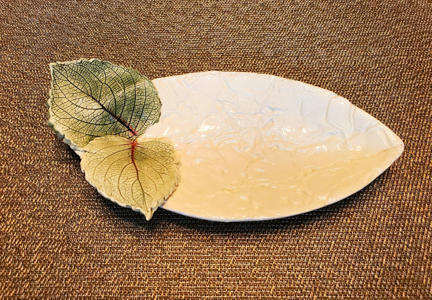 Image of Ceramic Oval Dish Highlighted with Two Ceramic Leaves