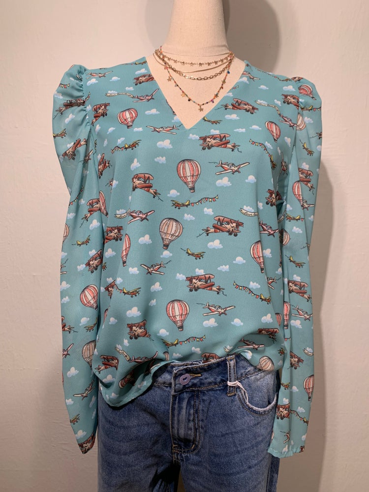 Image of BLUSA CON MONGOLFIERE AZZURRA