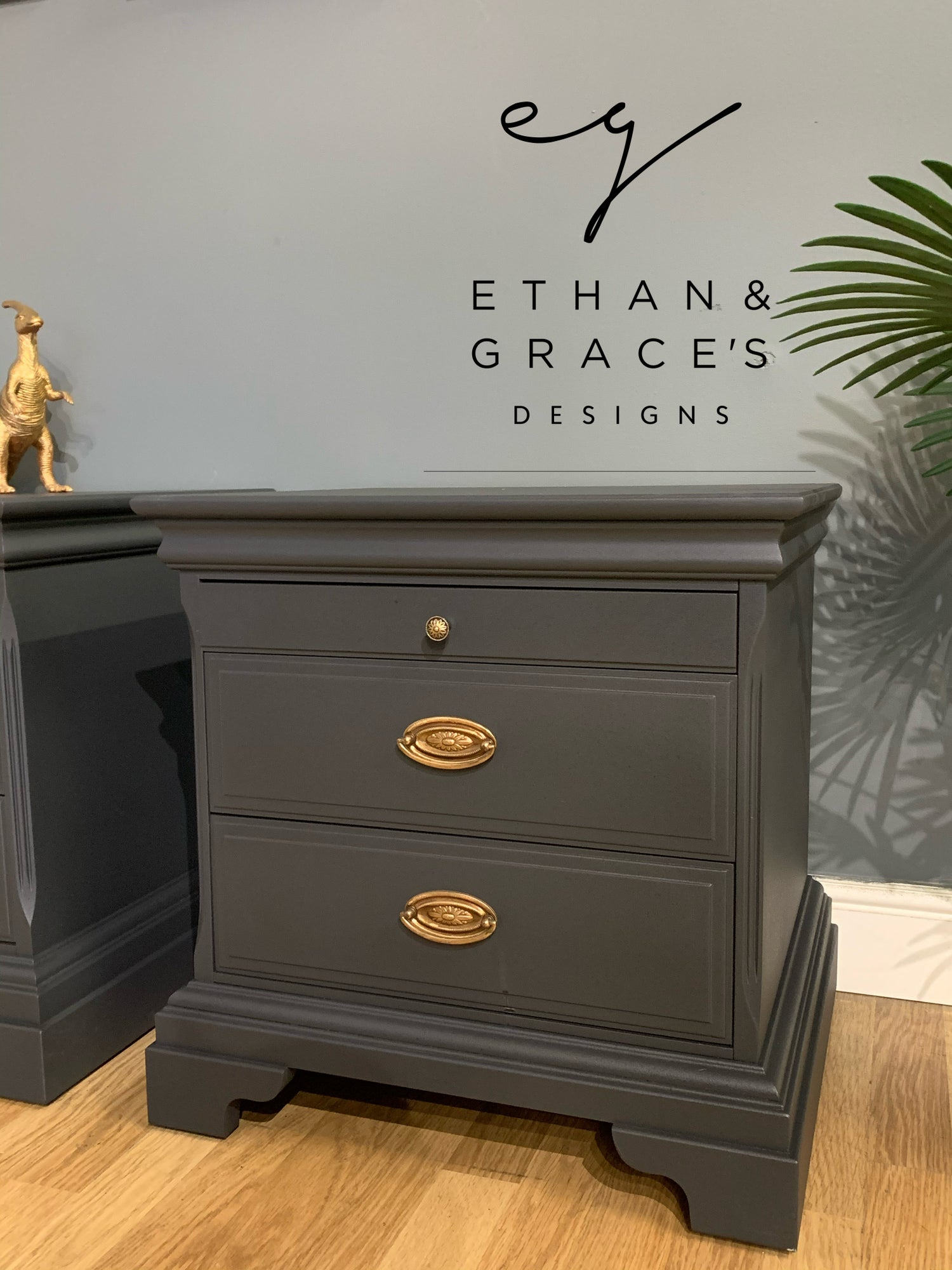 Image of A pair of mahogany Stag bedside tables in dark grey.