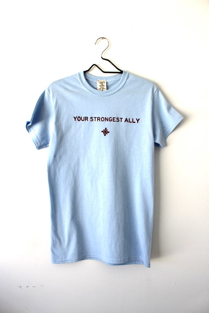 Image of your strongest ally tee in light blue