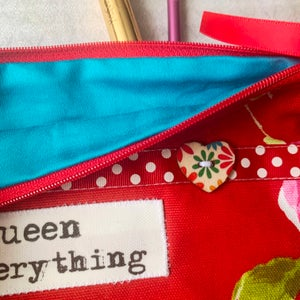 Image of Queen pouch in red floral
