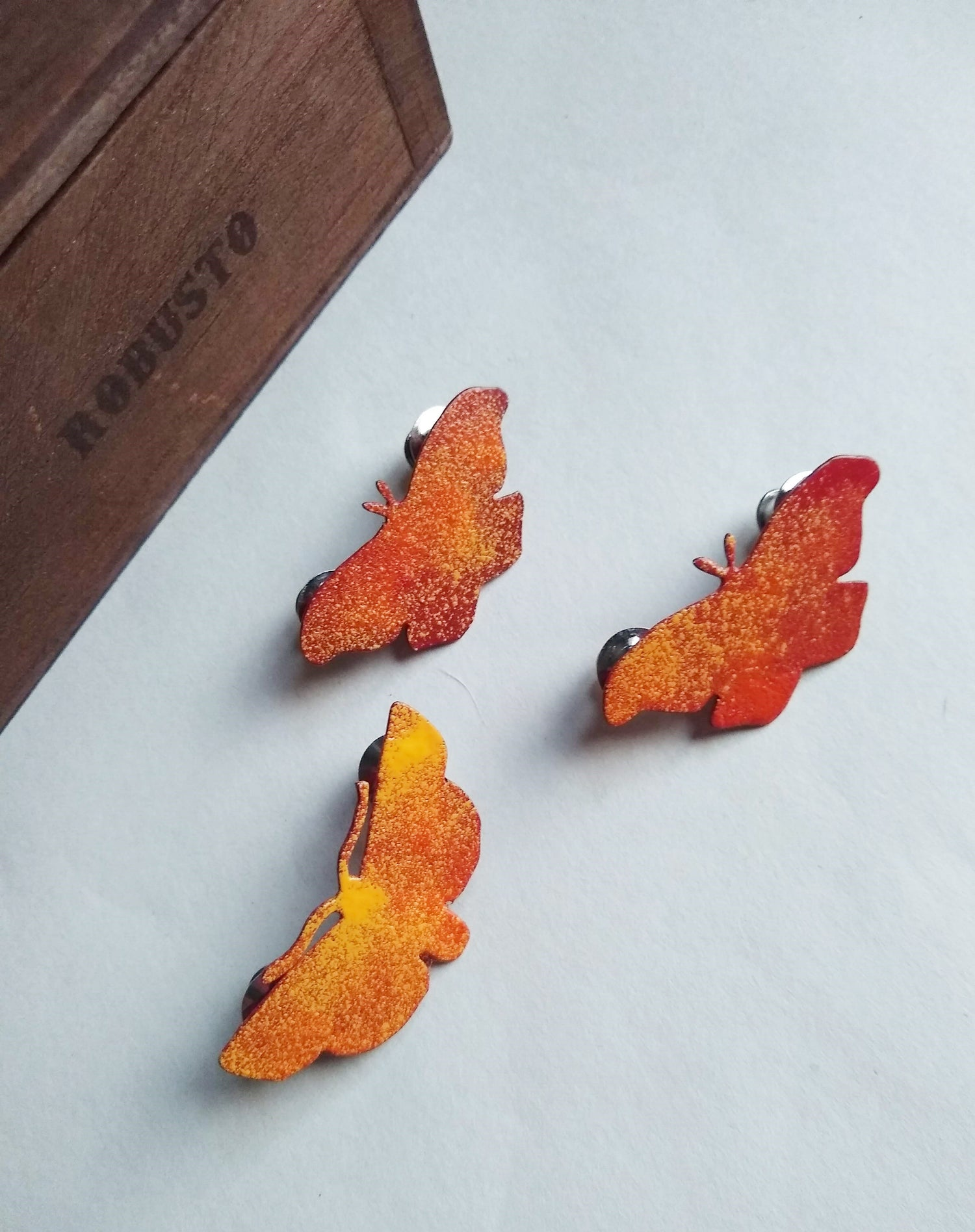 Image of Orange, Red, & Yellow Silk Moth Powdercoated and Hand Sawn Pin