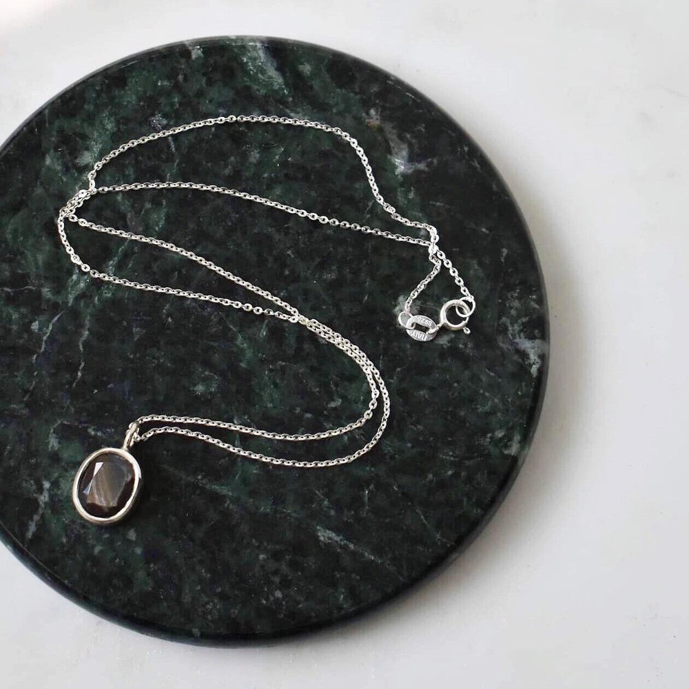 Image of Dark Green Sapphire oval cut silver necklace