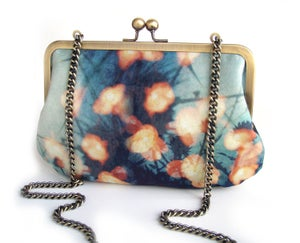 Image of Forest Lights, blue and orange velvet clutch bag with chain handle