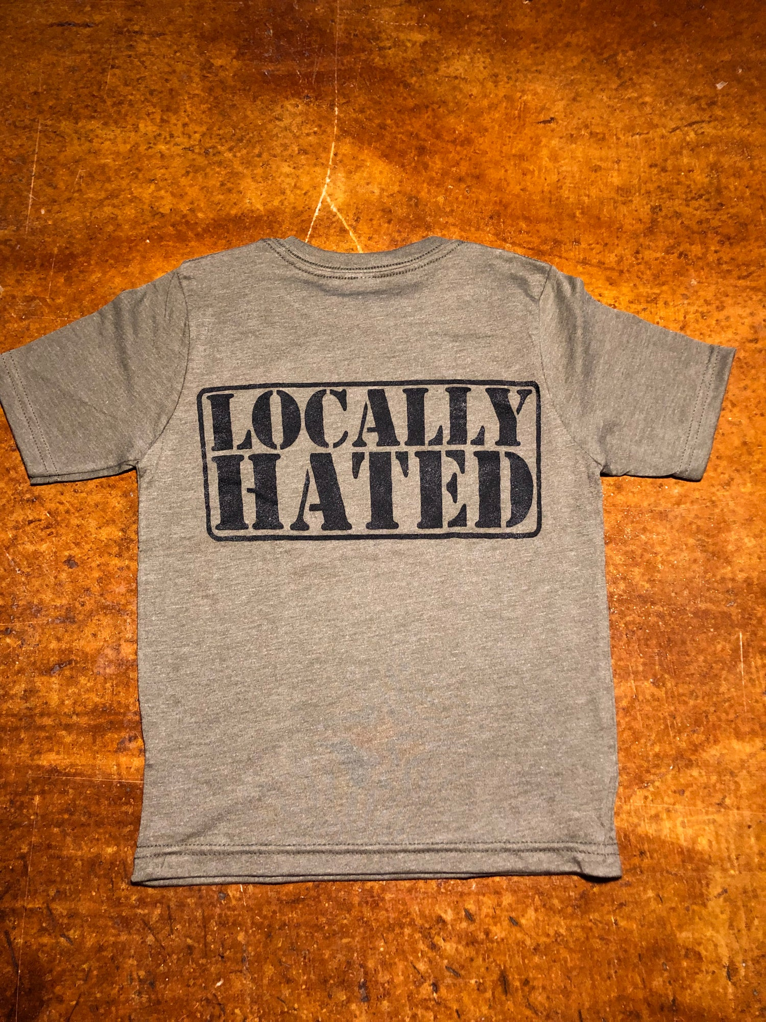 Image of Kids locally hated badge t-shirts