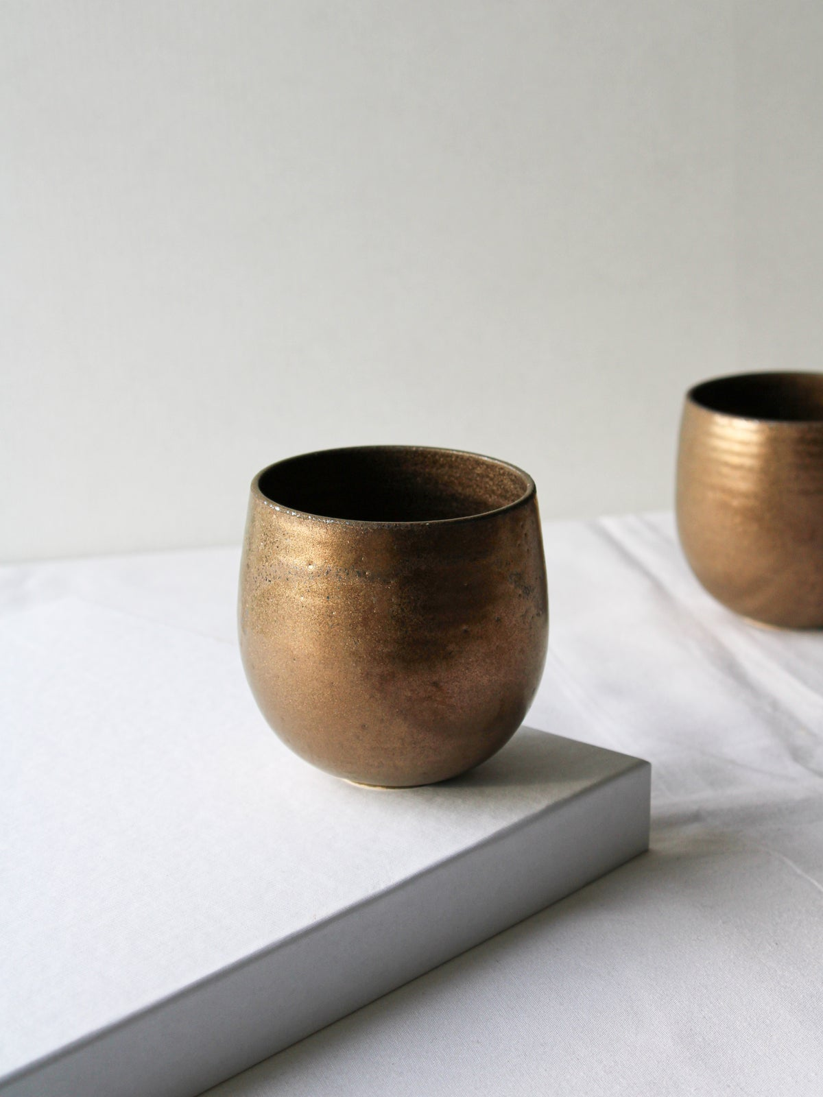 Image of cup in gold