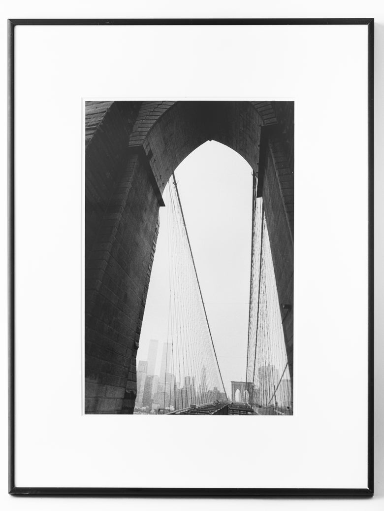 "Image of Brooklyn Bridge and Twin Towers, September 2001. 16""x20"" framed."