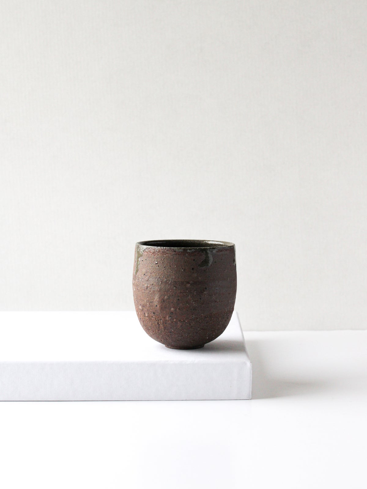 Image of medium cup in brown clay