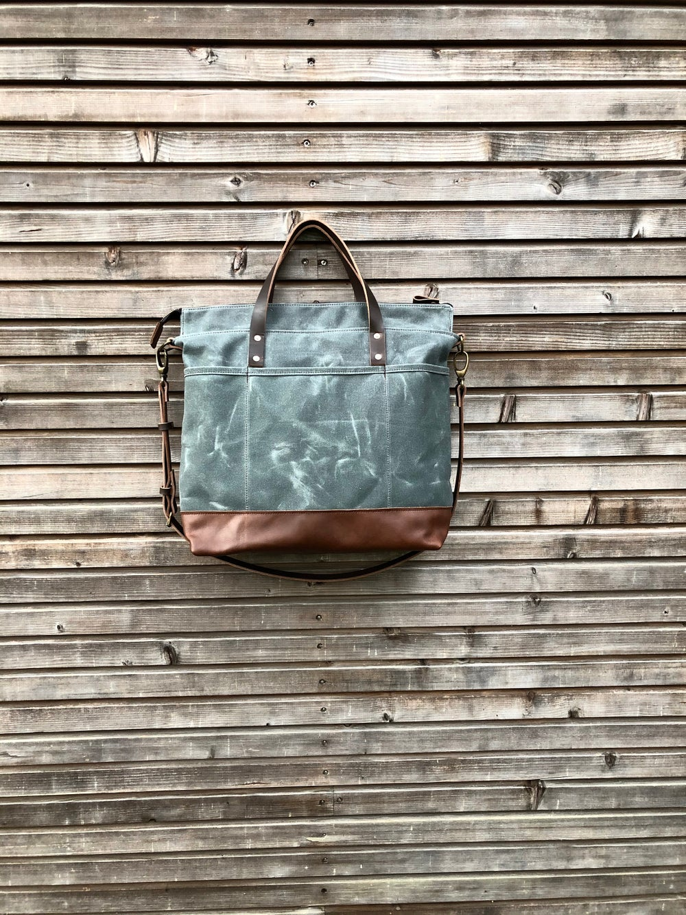 Image of Waxed canvas office bag with luggage handle attachment leather handles and shoulder strap